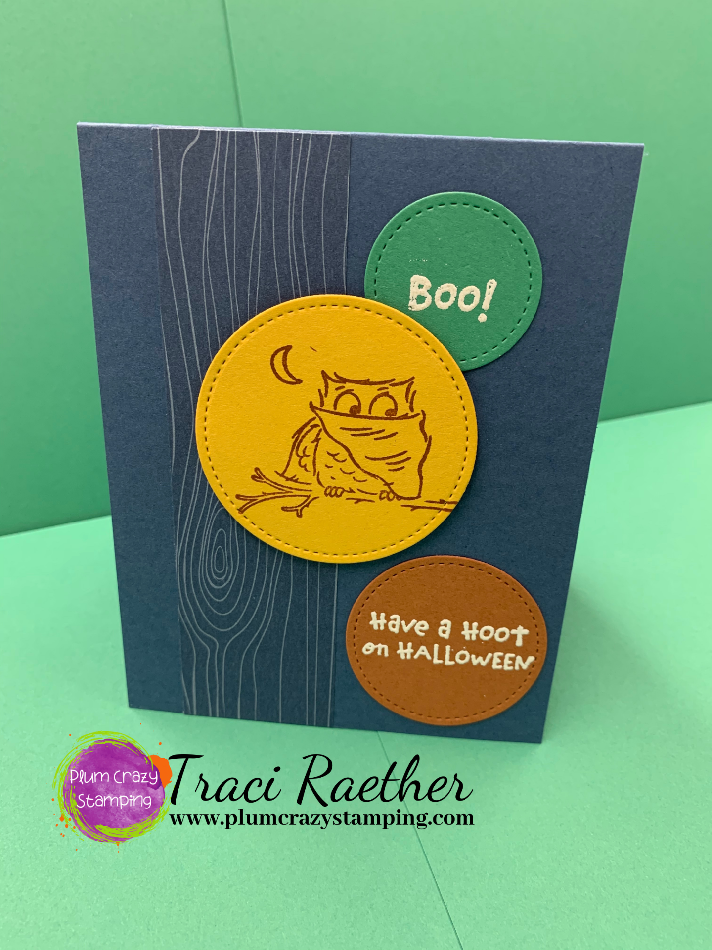 Dark blue card with owl in a dracula cape stamped on a yellow circle. Sentiments of Boo on green circle and Have a Hoot Halloween on a brown circle.