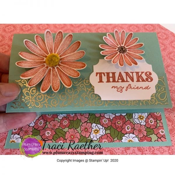 """Light green card with two daisies on card front with a """"Thanks"""" sentiment."""