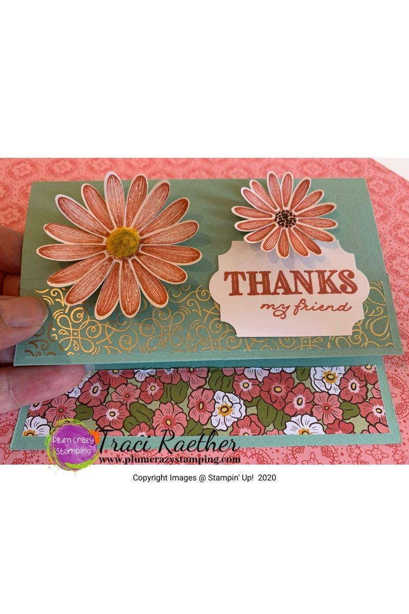 "Light green card with two daisies on card front with a ""Thanks"" sentiment."